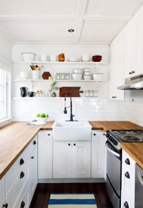 Shelves on empty kitchen wall