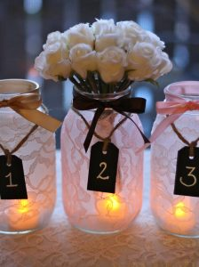 Flowers with candle in a jar