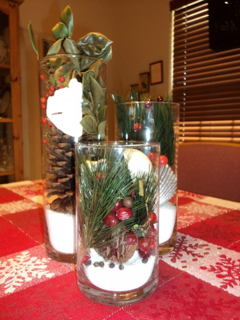 jar with pinecone and berries