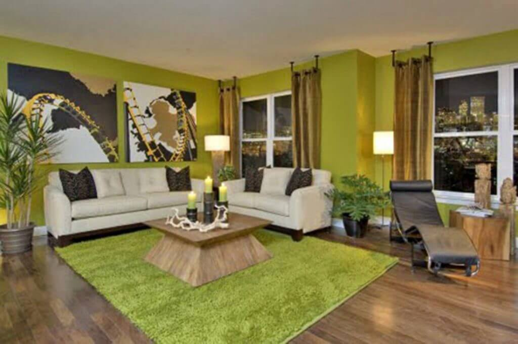 Green living room with pictures on the wall