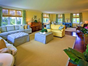 Livin room with yellow sofa and green curtains