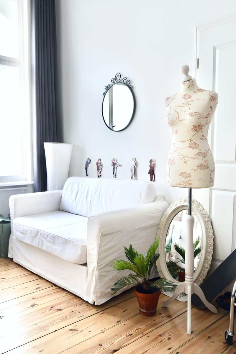 Brighten your home with some mirrors and a white couch